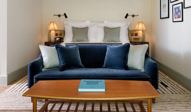 Bespoke hand finished upholstered blue velvet sofa